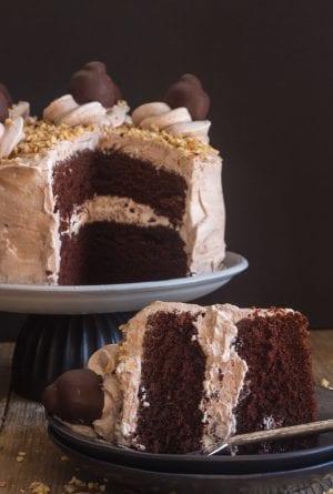chocolate cake a slice on a black plate