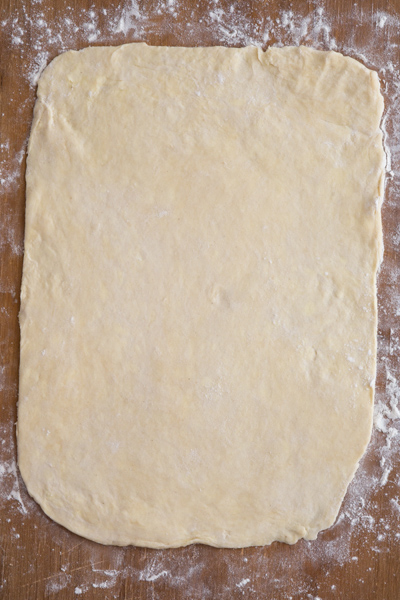 Dough rolled to form a rectangle.
