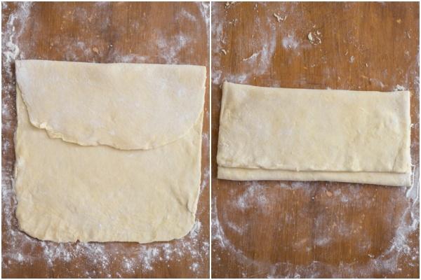 Dough folded on a wooden board.
