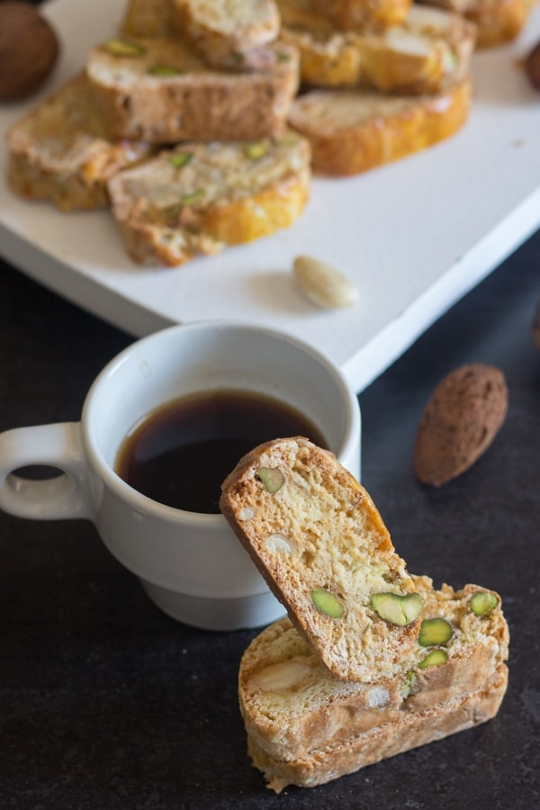 three nut biscotti on a cup and a white board