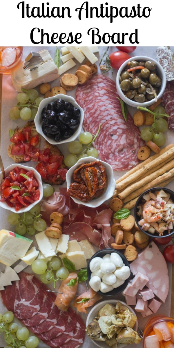 The perfect addition to any party or get together. This Italian Antipasto Cheese Board is easy to put together and holds all the delicious Italian finger foods that guests love to eat. #cheeseboard #Italianantipastoboard #antipasto #Italianrecipe #appetizers