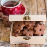chocolate canestrelli cookies in a wooden box with a cup of tea