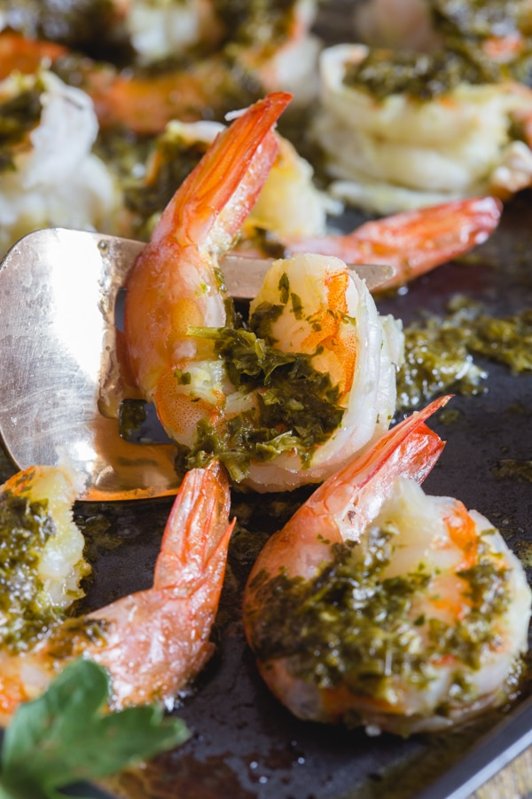 shrimp up close on a black pan