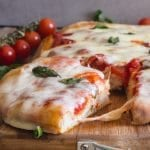 a slice cut of no knead pizza dough Pizza Margherita