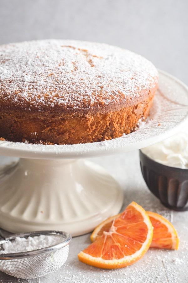 orange cake on a white cake stand