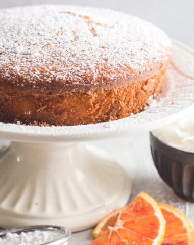 orange cake on a white cake stand