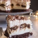 tiramisu cheesecake with a slice on a plate