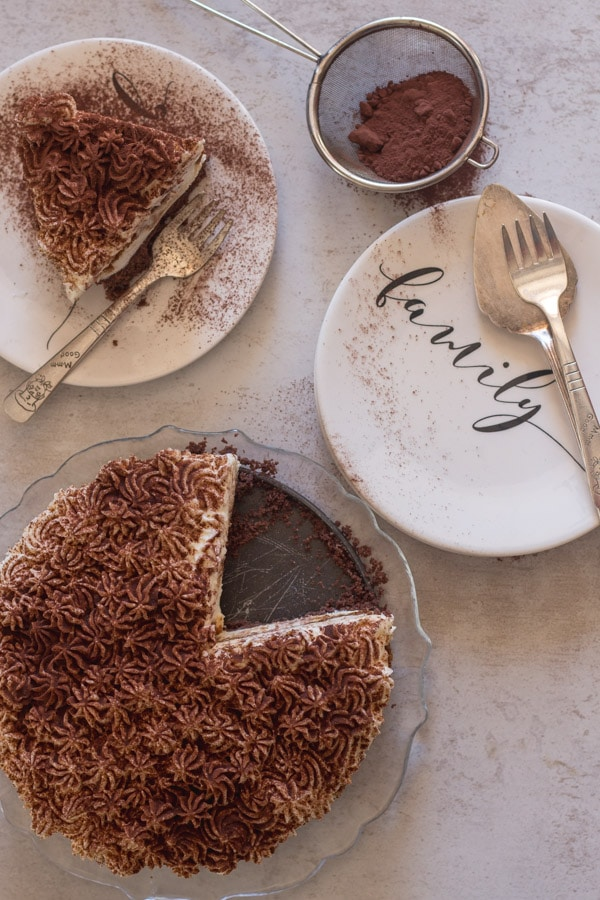 tiramisu cheesecake on a plate and a glass dish