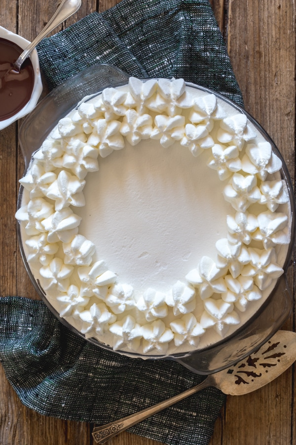 baileys mousse pie on a wooden board