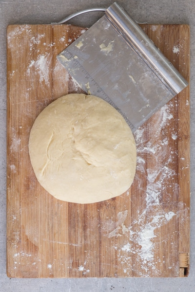 kneading the dough into a smooth ball