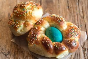 2 easter breads on a wooden board
