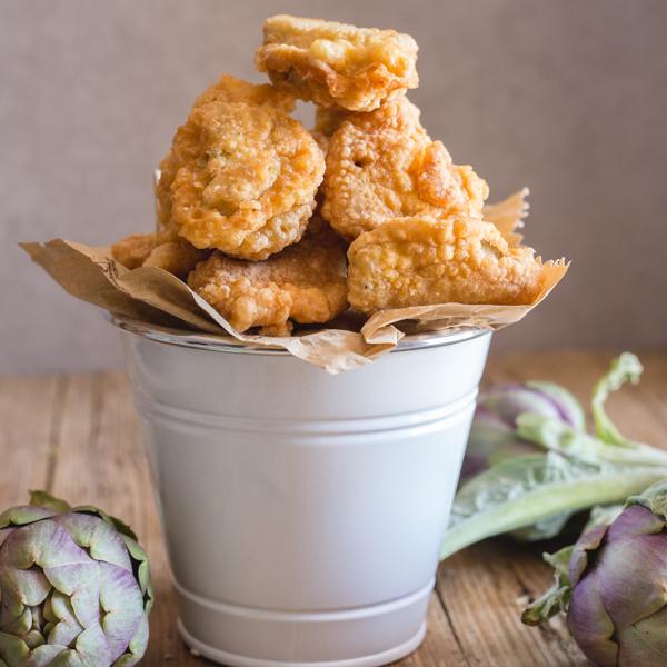 fried artichokes in a white bucket