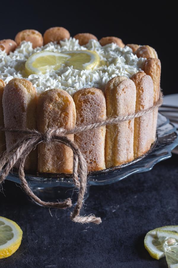 lemon charlotte on a glass cake dish