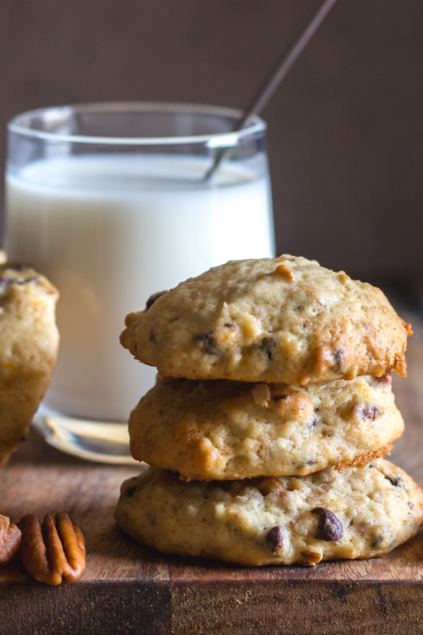 banana chocolate chip cookies 3 stacked with a glass of milk