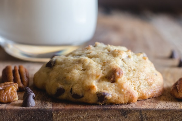 one banana chocolate chip cookie on a wooden board