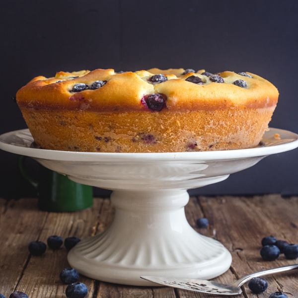 blueberry cake on a white stand