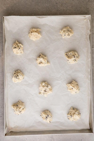 cookie dough dropped by teaspoon full on cookie sheet