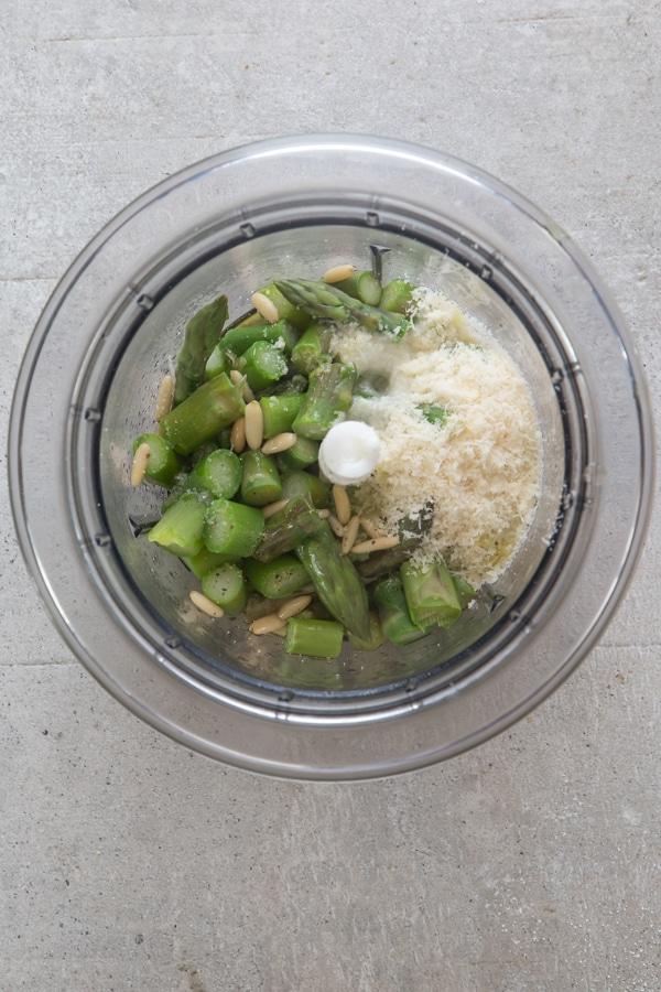 ingredients for asparagus pesto in a blender