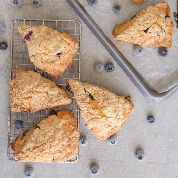 blueberry scones on a pan and a grey board