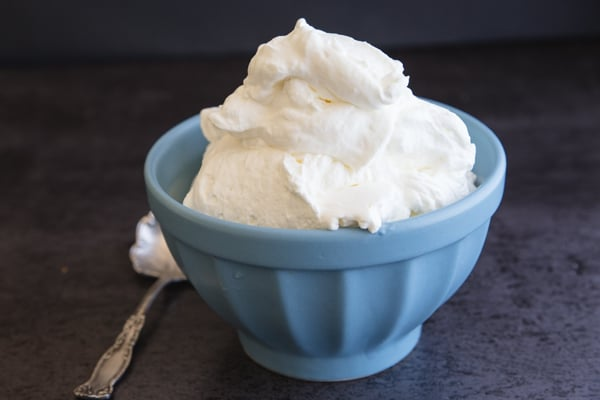 stabilized whipped cream in a blue bowl