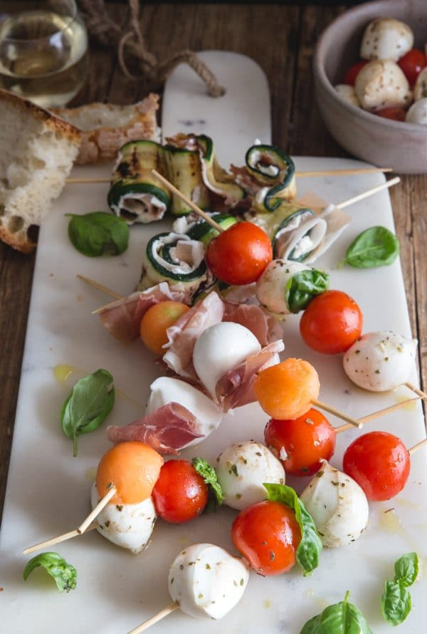 antipasto skewers on a white board