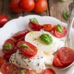 caprese salad in a white plate
