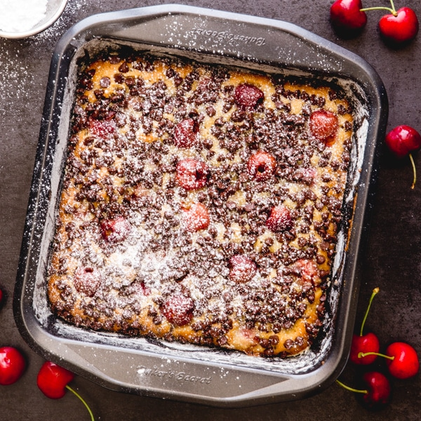 baked cherry blondies in a square pan