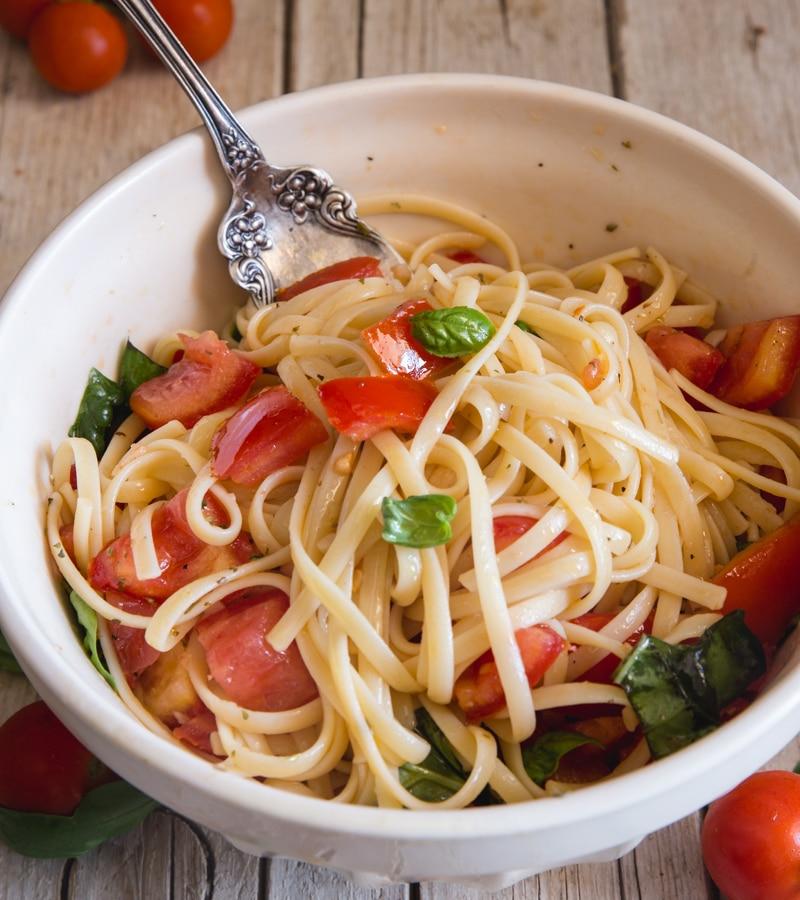pasta alla checca in a white bowl