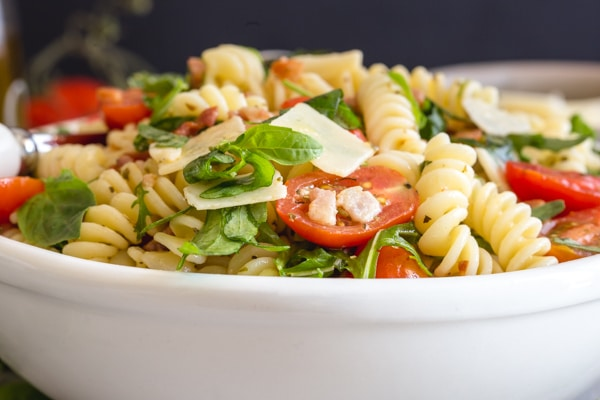 up close pasta salad in a white bowl
