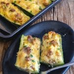 stuffed zucchini on a plate and in the pan