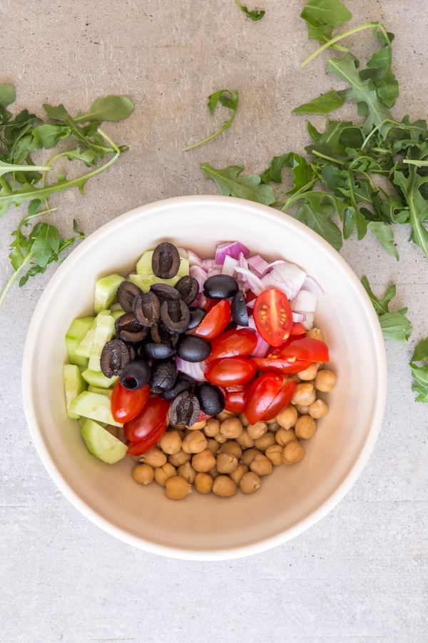 ingredients for chickpea salad in a white bowl