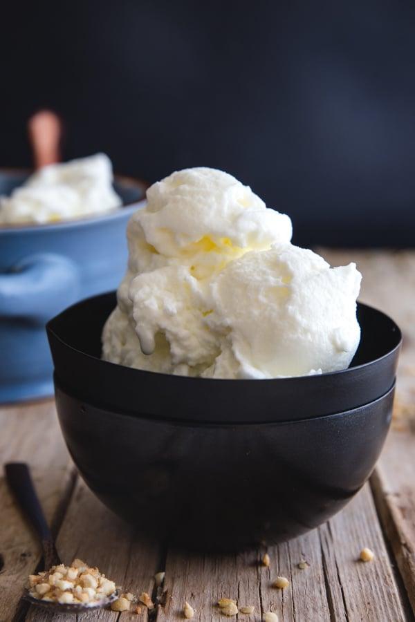 fior di latte gelato in a black bowl