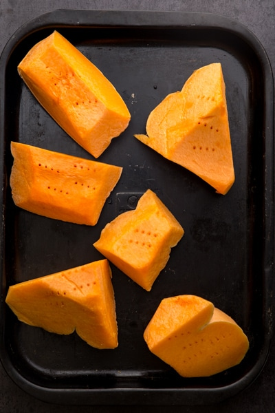 chunks of pumpkin on a cookie sheet