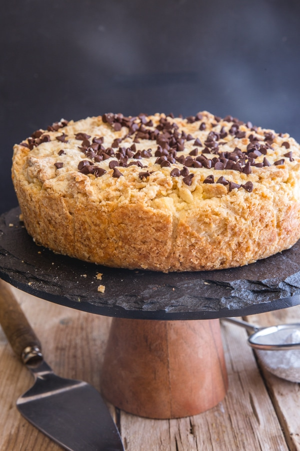 ricotta crumb cake on black cake stand