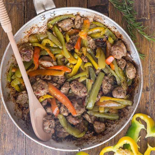 sausage and peppers in a silver pan