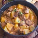 beef & potato stew in a large red and black pot