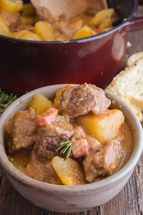 beef and potato stew in a white bowl