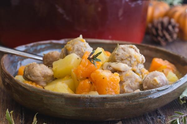 pumpkin stew in a brown bowl