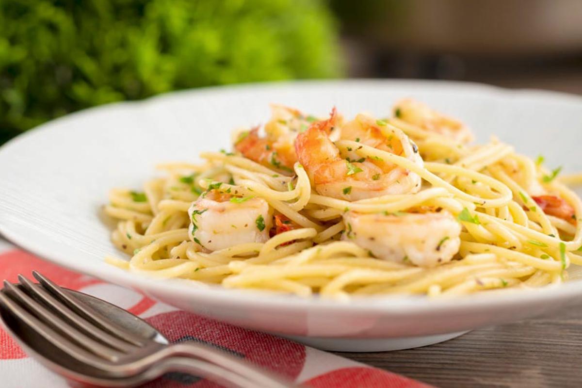 Shrimp & pasta on a white plate.
