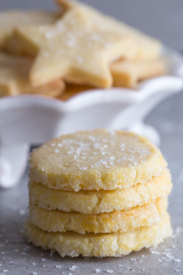 sliced sable cookies with cut out cookies on a white plate stand