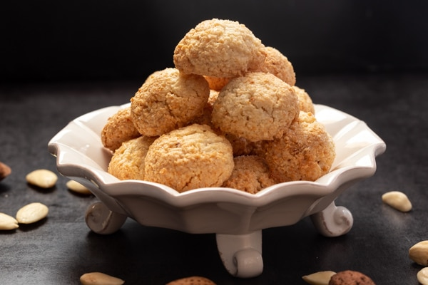 amaretti cookies on a white cake plate