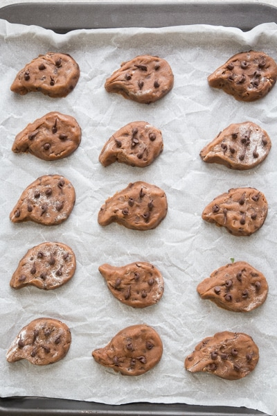 the cut out cookies on parchment paper cookie sheet ready for baking