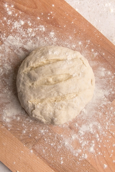 the dough ready for baking on a wooden board