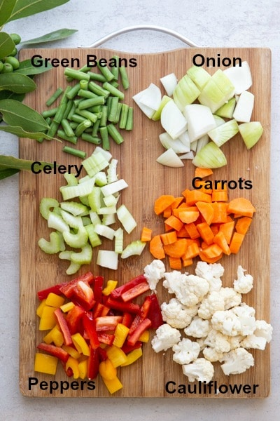 the chopped vegetables on a wooden board