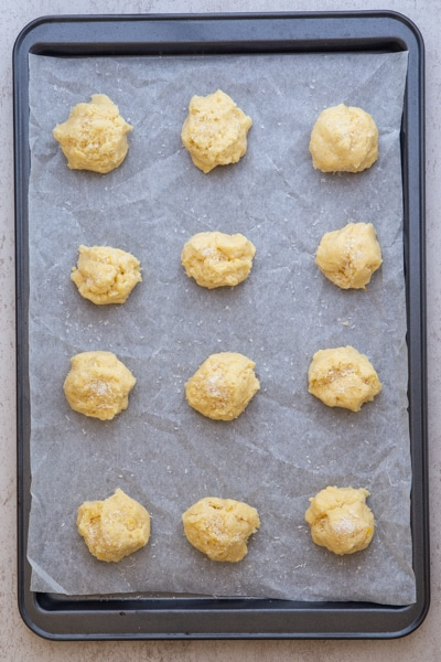 cookies on parchment paper lined cookie sheet ready for baking