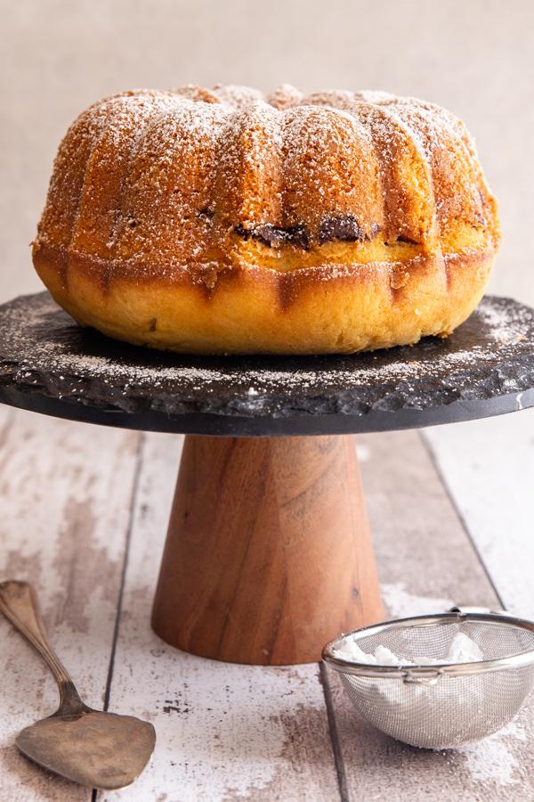 margherita cake on a black cake stand