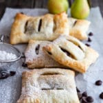 5 pear pastries on a white paper