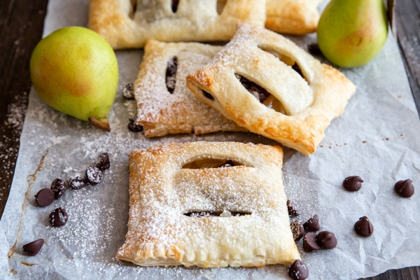 pastries on parchment paper with 2 pears