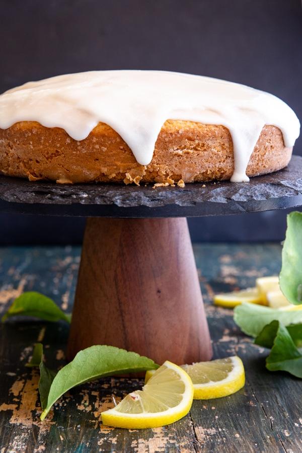 lemon cake on a black cake stand