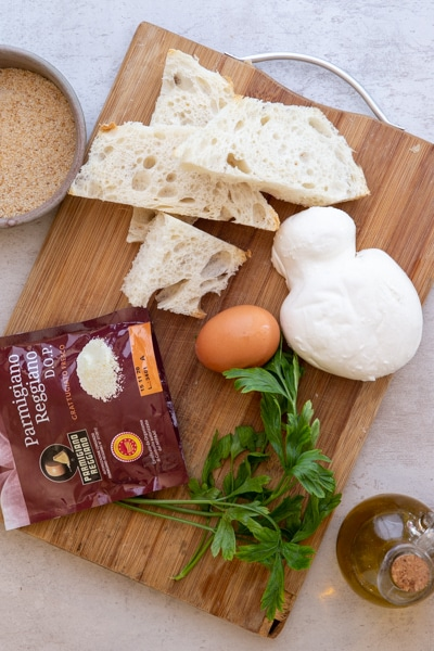 ingredients on a wooden board for mozzarella balls